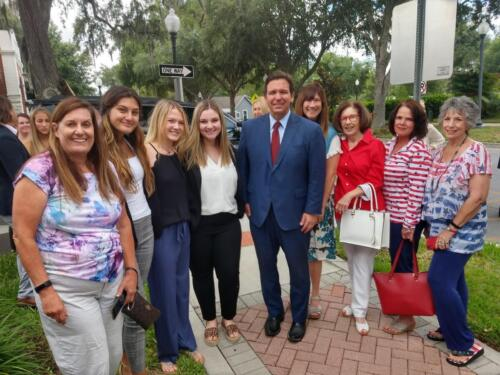 Governor DeSantis in Pasco to Sign Budget, with are Debbie, 3 students, Ron, Sandy, Me, Roxanne  Ann